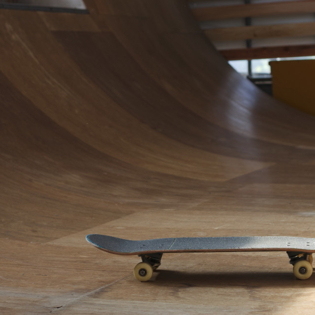 """skate board on half pipe ramp"" stock image"