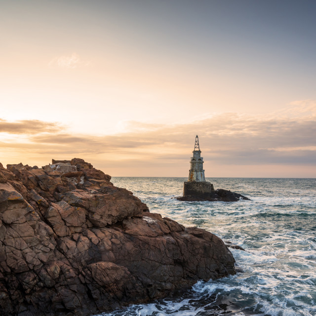 """""""Sunrise at the lighthouse in Ahtopol, Bulgaria."""" stock image"""