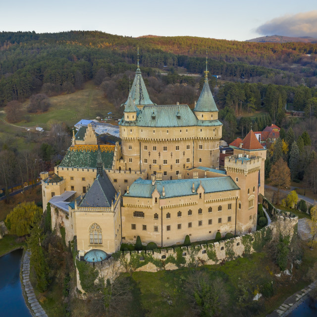"""""""Aerial view of Bojnice castle in Slovakia guarded by its moat and surrounded..."""" stock image"""