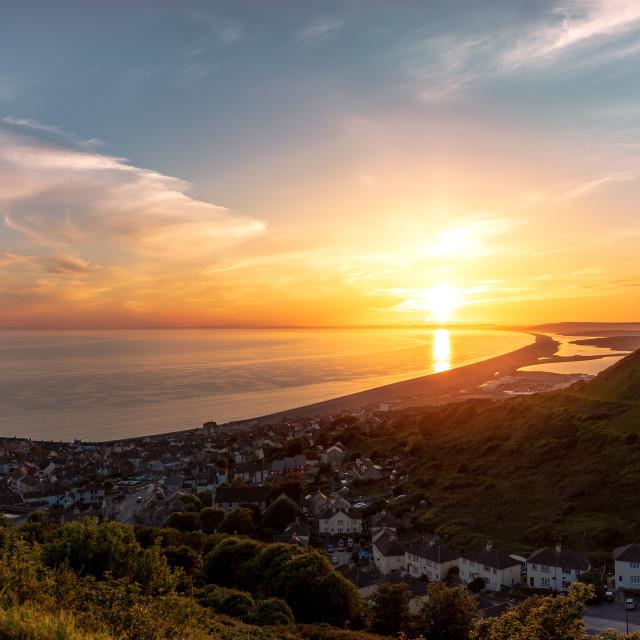"""Sunset over Chesil Beach in Dorset"" stock image"
