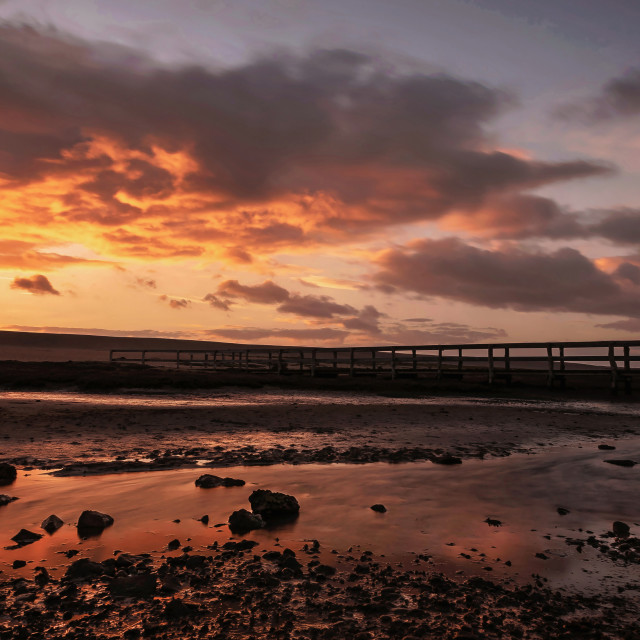 """Golden winter sunset over the bridge to Chesil Beach"" stock image"