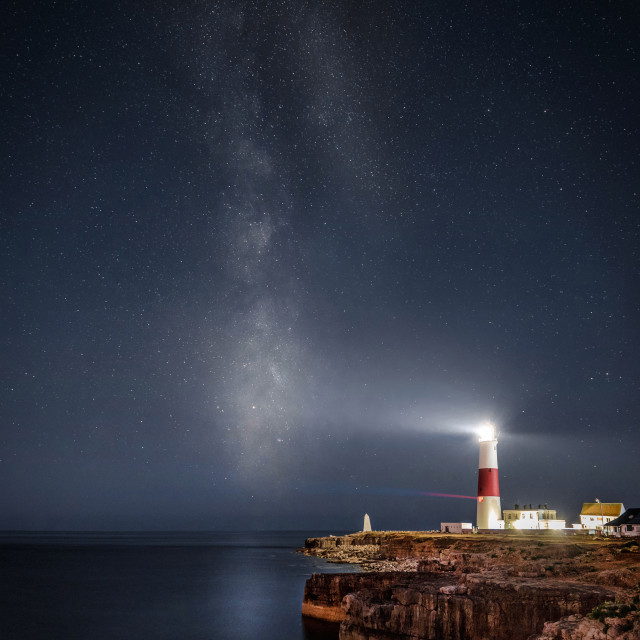 """""""The Milky Way Over Portland Bill Lighthouse and Ocean"""" stock image"""