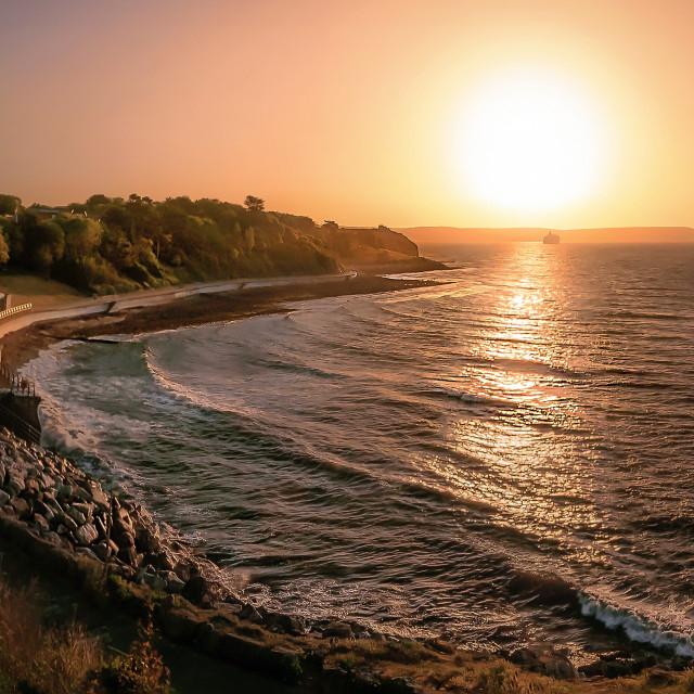 """Newtons Cove Sunrise in Weymouth, Dorset"" stock image"