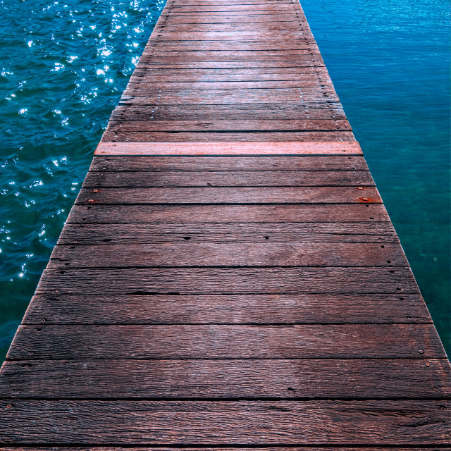 """Wooden boardwalk over a lake"" stock image"