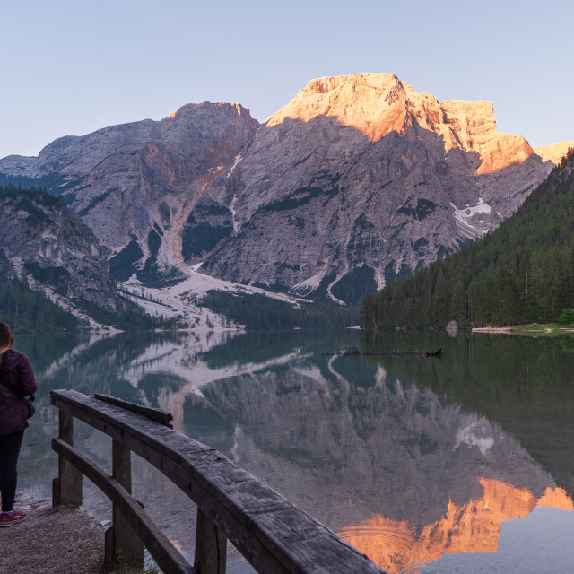 """""""A person looks out over Lake Braies"""" stock image"""