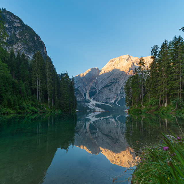 """""""The mountain lake of Braies immersed in the green of South Tyrol"""" stock image"""