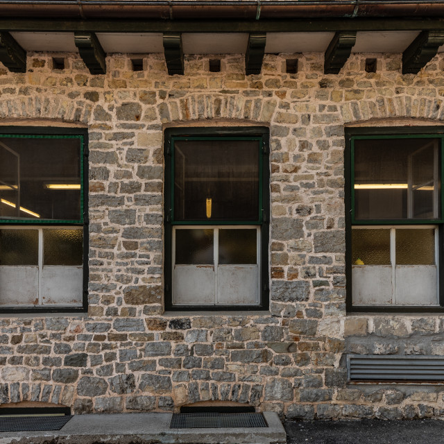 """""""Series of windows lined up on a building of clear stones"""" stock image"""