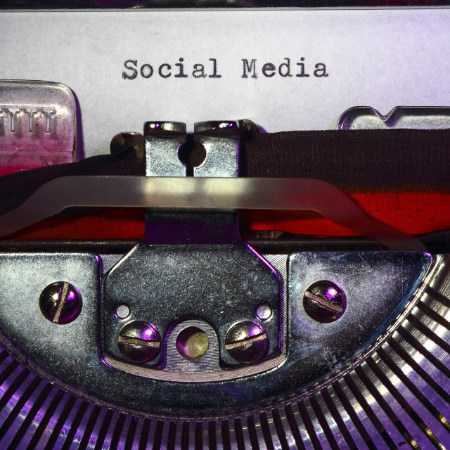 """Vintage typewriter with the word Social Media"" stock image"
