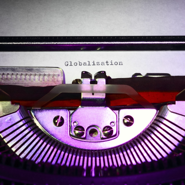 """Vintage typewriter with the word Globalization"" stock image"