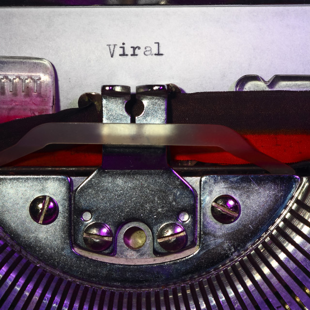 """Vintage typewriter with the word Viral"" stock image"