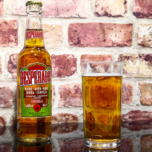 """Bottle and glass of desperados tequila flavoured lager"" stock image"