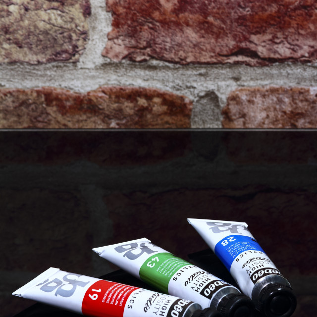 """""""Tubes of artists acrylic paint on a glass table"""" stock image"""