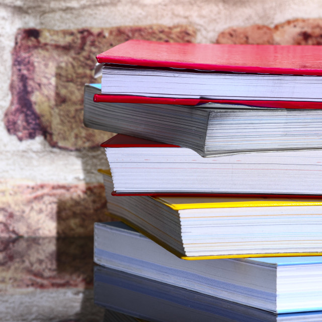 """""""Stack of reading books on a glass table"""" stock image"""