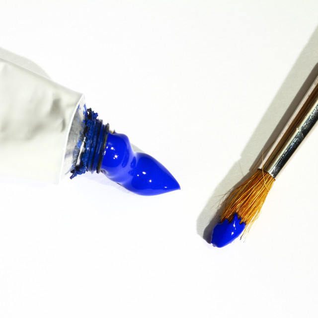 """""""Artists paint brush and tube of blue paint isolated on a white background"""" stock image"""