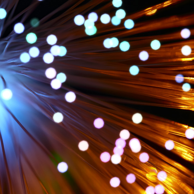 """""""Fibre optic strands with light passing through"""" stock image"""