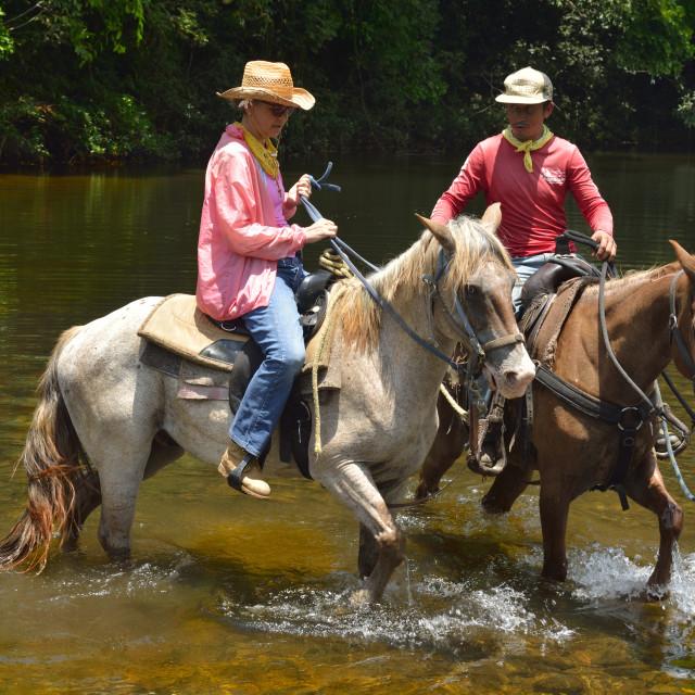 """River crossing on Horseback"" stock image"