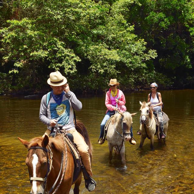 """Riding across a river"" stock image"