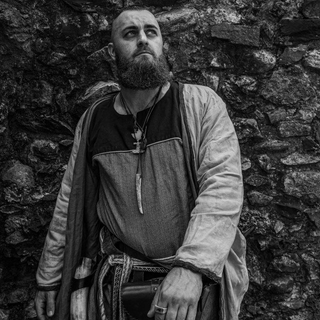 """""""Viking warrior portrait with thick beard in front of a stone wal"""" stock image"""