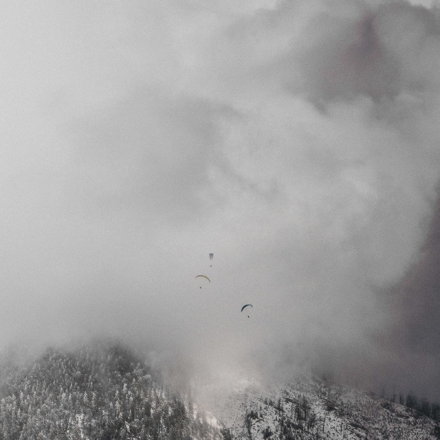 """""""Parachuting in the winter over the Austrian Alps"""" stock image"""