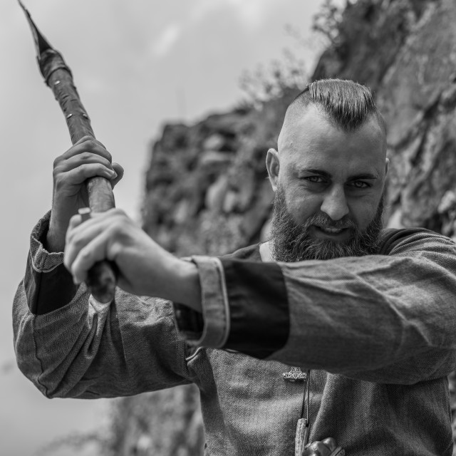 """""""Viking warrior with thick beard brandishes an ax"""" stock image"""