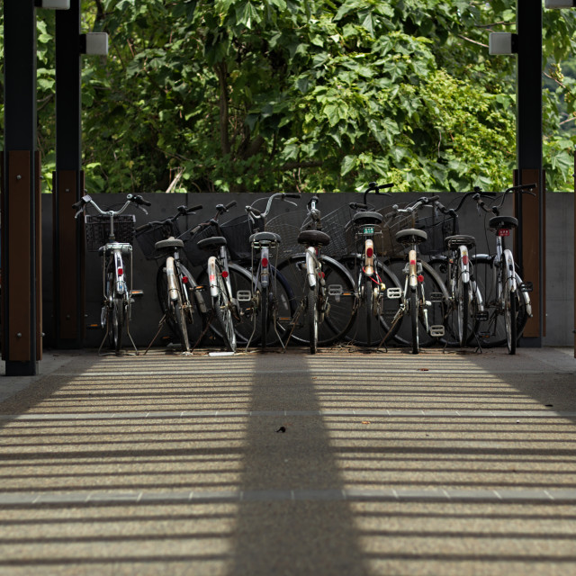 """Bicycles parked at train station japan"" stock image"
