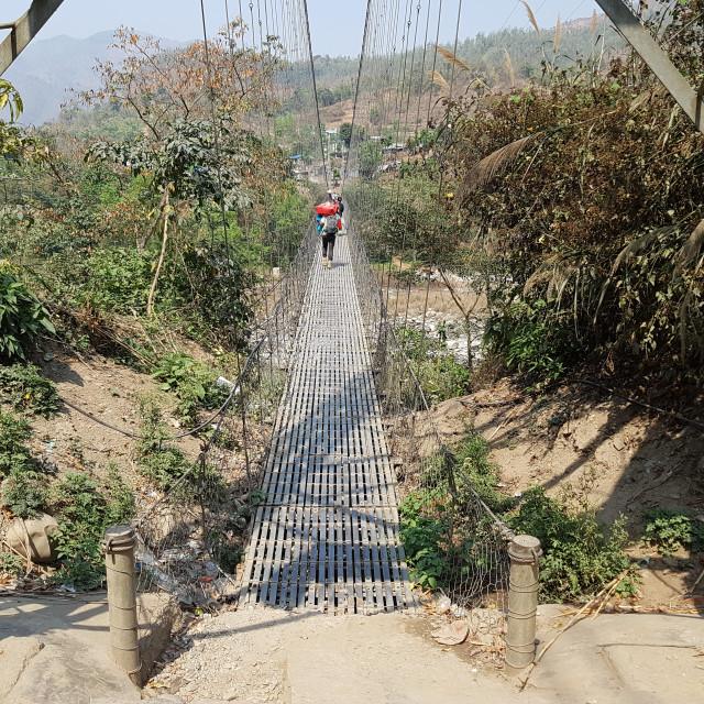 """Pedestrian bridge, Nepal"" stock image"