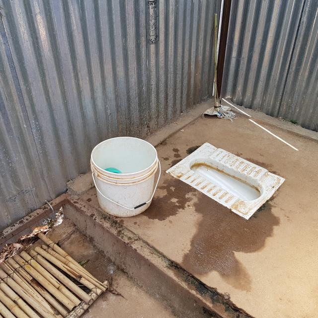 """Basic Toilet and Bucket Shower"" stock image"