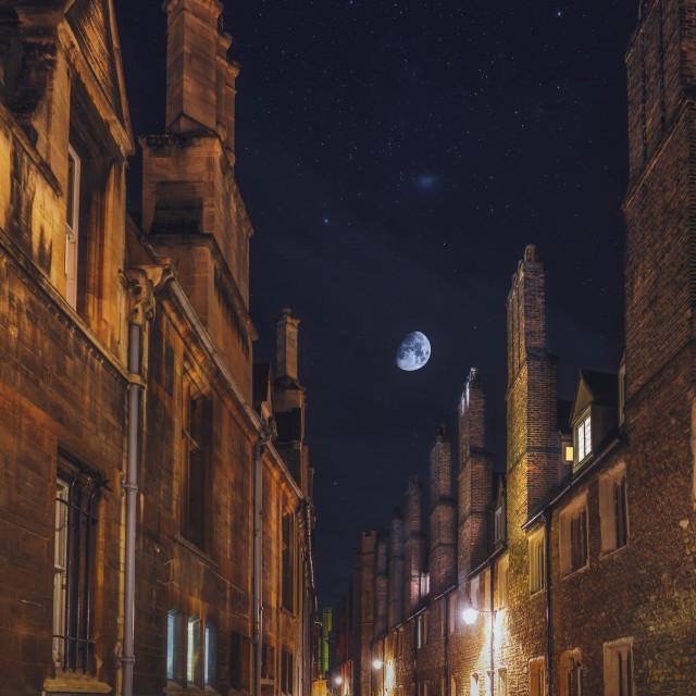 """Moonset on Trinity Lane, Cambridge UK."" stock image"
