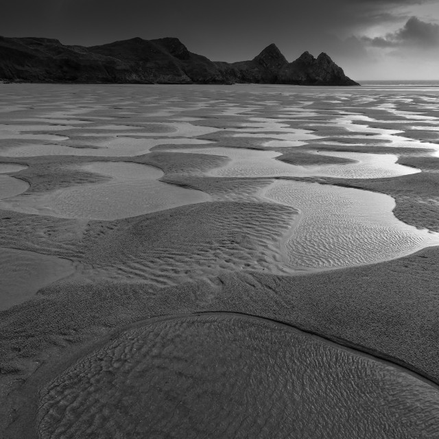 """Low tide, Three Cliffs Bay"" stock image"