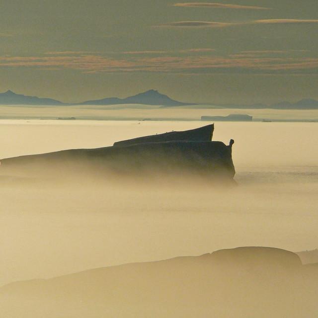 """Iceberg in morning mist"" stock image"