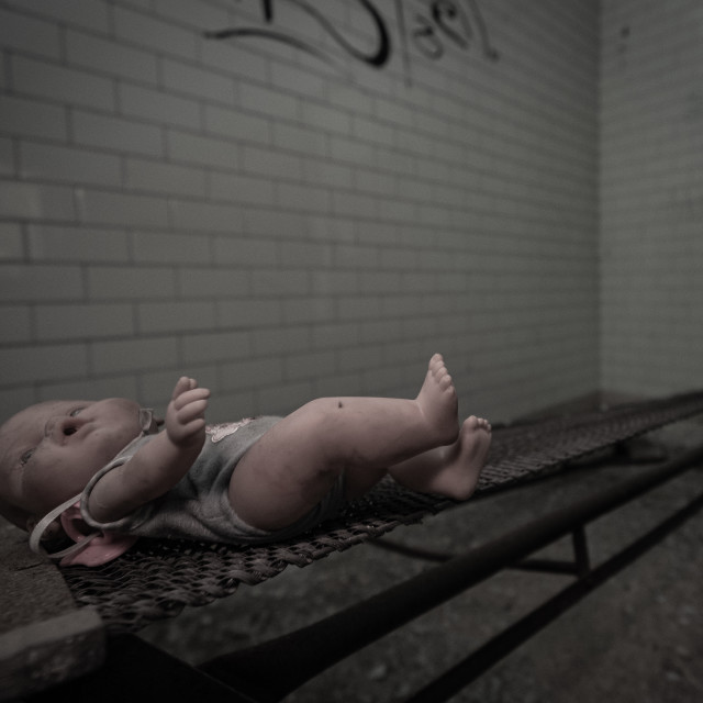 """""""A vintage doll abandoned in the rooms of an abandoned psychiatri"""" stock image"""