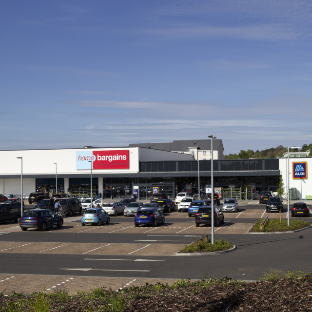 """Home Bargains and Aldi stores on the old Rolls-Royce site"" stock image"