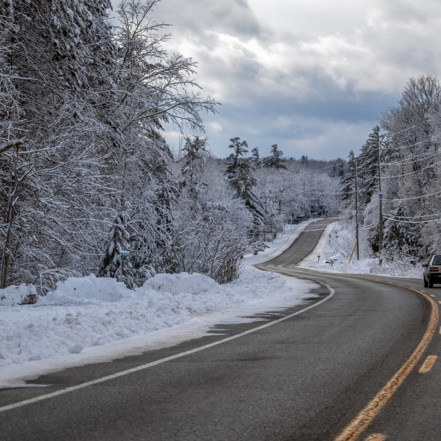 """""""Driving Down a Winding Winter Country Road"""" stock image"""