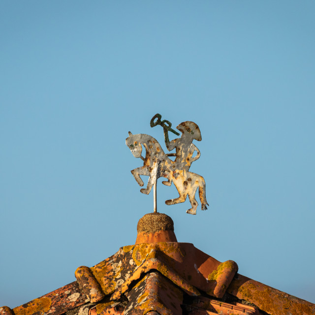 """""""Old brass weather vane on a rooftop"""" stock image"""