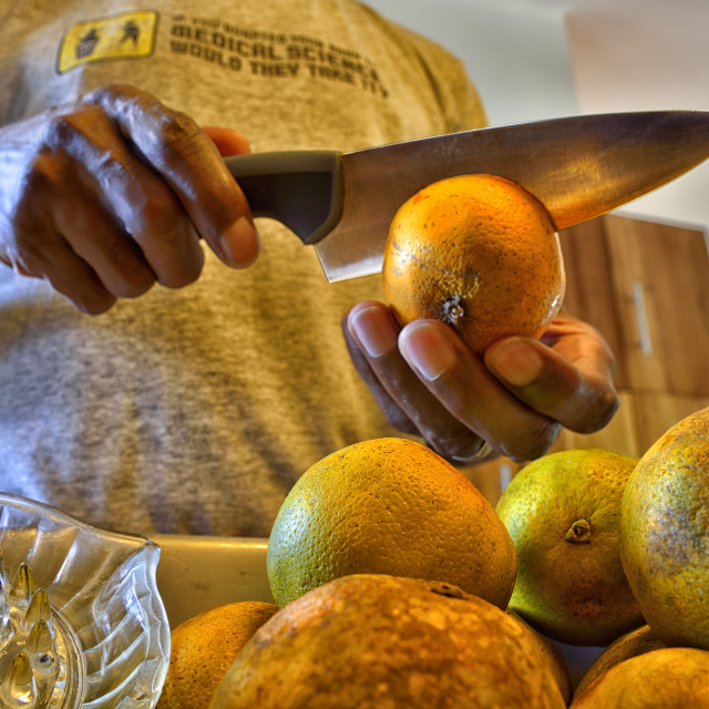 """""""Cutting and juicing oranges"""" stock image"""