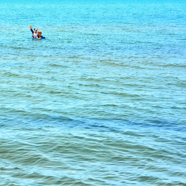 """""""Woman and dog in the sea"""" stock image"""