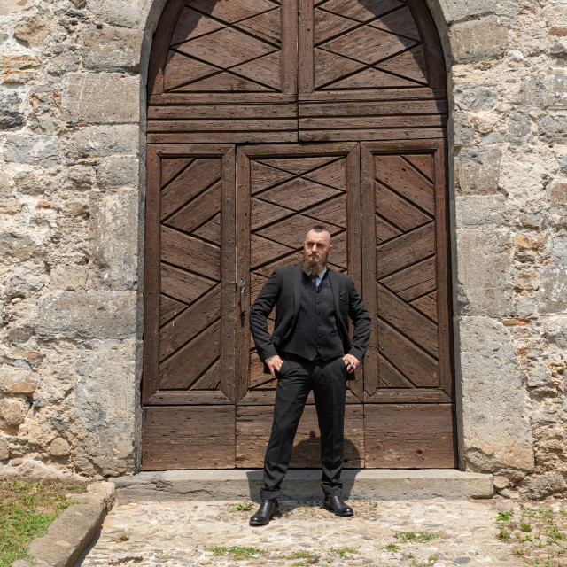 """""""Groom waits for his future wife in front of the church"""" stock image"""