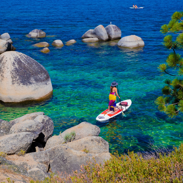 """""""Unidentifiable woman Standup Paddleboard in Lake Tahoe"""" stock image"""