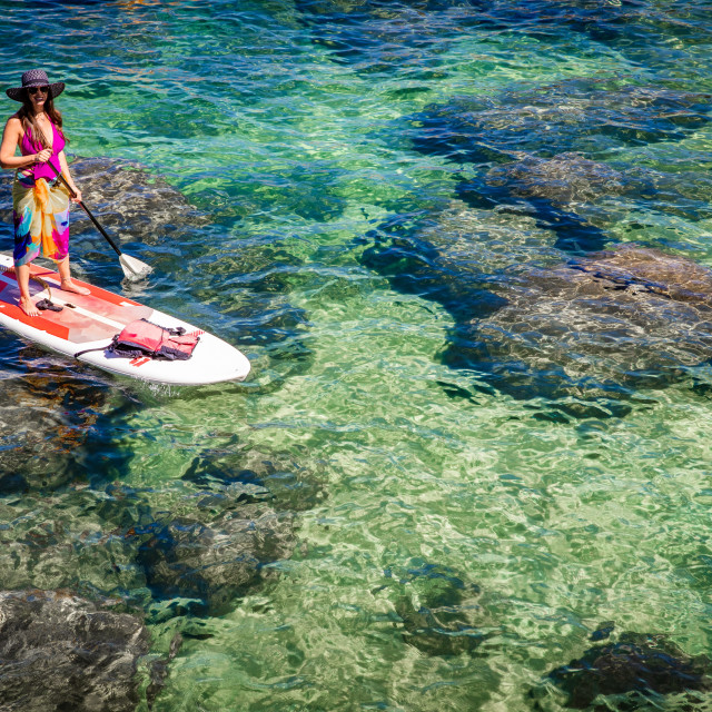 """""""Aerial photo of woman standup paddle boarding on Lake Tahoe"""" stock image"""