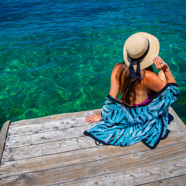 """""""woman on dock with emerald water"""" stock image"""