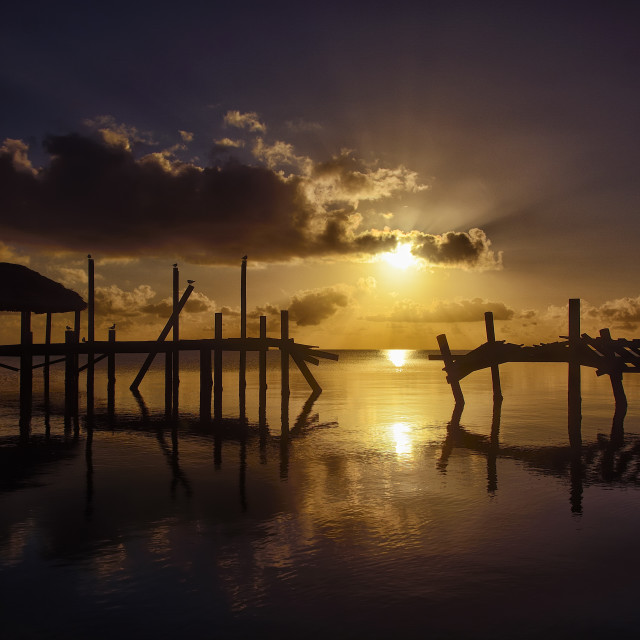 """Sunrise and broken dock"" stock image"
