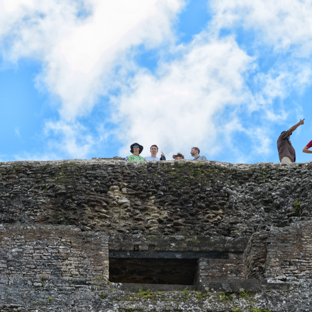 """""""Tourists on the ruins at Xunantunich"""" stock image"""
