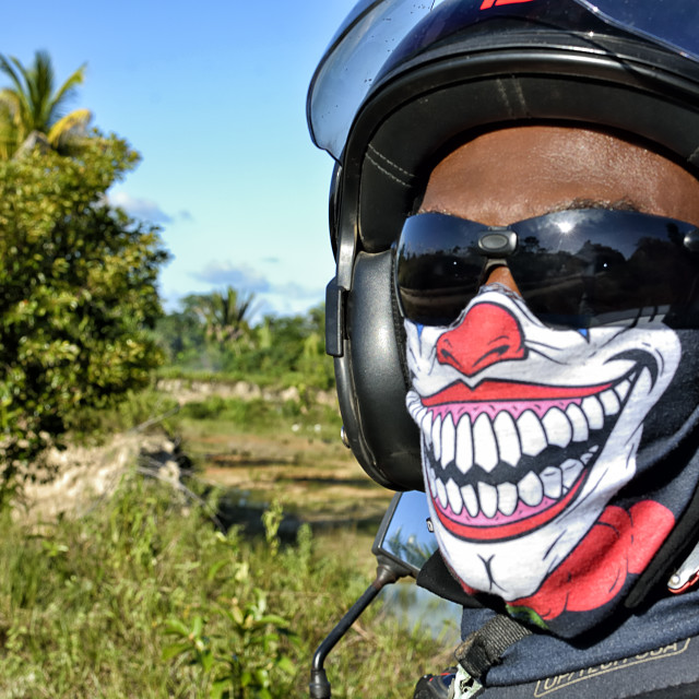 """""""Motorcylist head wearing a face protector"""" stock image"""