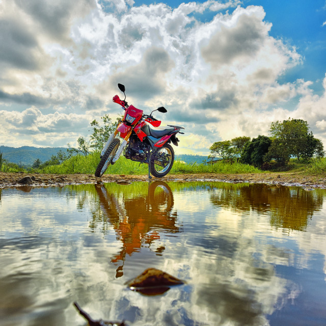 """""""motorcycle by a pool of water"""" stock image"""