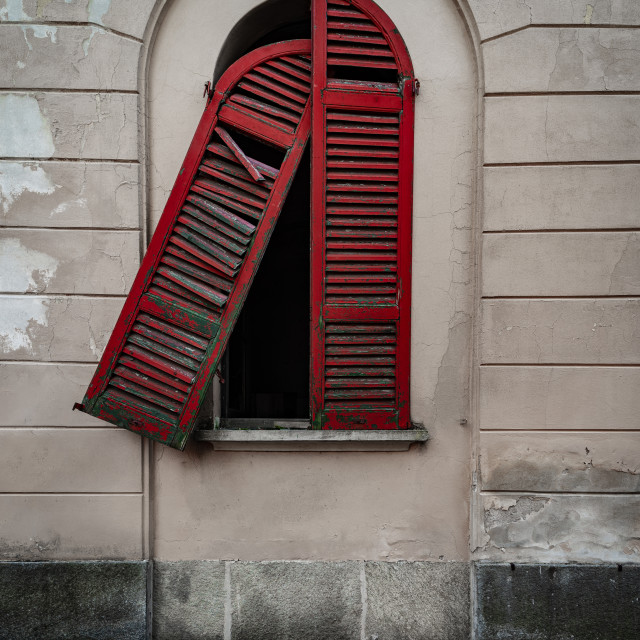"""""""Red doors of a window of an old dilapidated Italian building"""" stock image"""