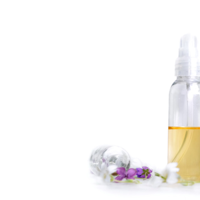 """front view of essential oil and petals of flowers in bottle in p"" stock image"