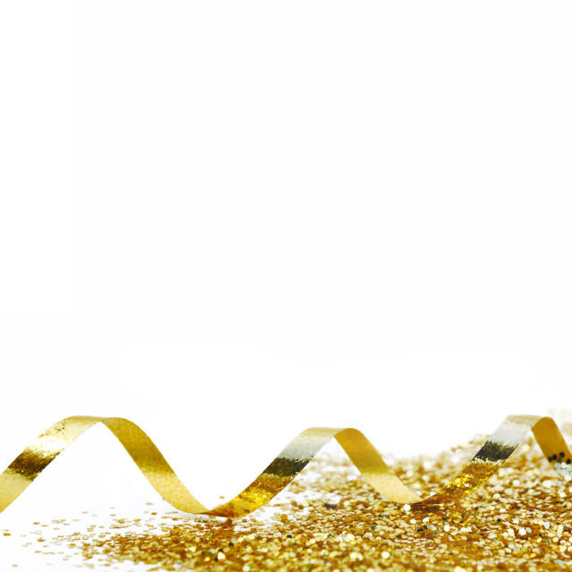"""ribbon curling and golden confetti on white background in panoramic view"" stock image"