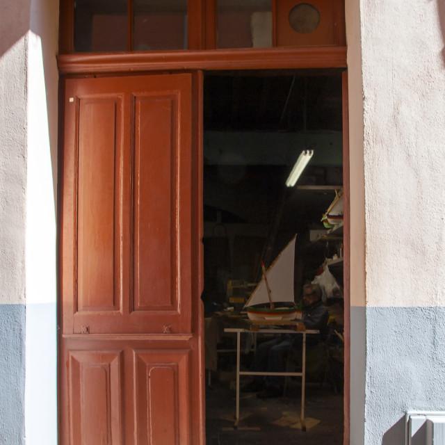 """Back street French model maker's workshop, Collioure"" stock image"