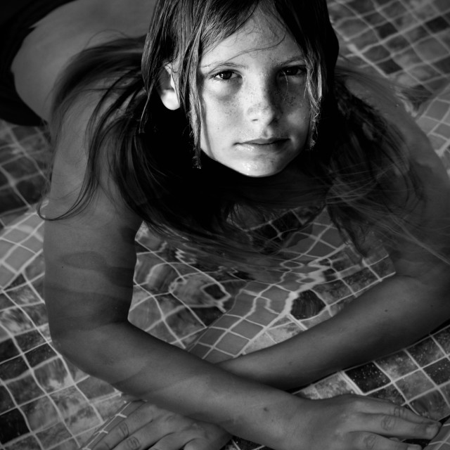 """""""Blond long haired boy in Pool, Black & White"""" stock image"""