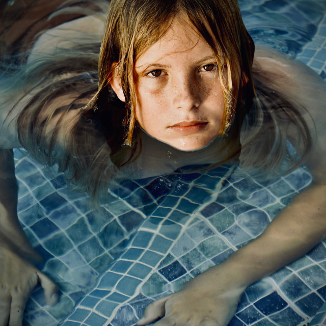 """""""Blond long haired boy in Pool"""" stock image"""